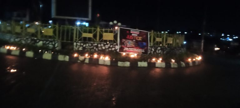 PHOTOS: Amid tension, #EndSARS protesters hold candlelight procession for victims in Osun