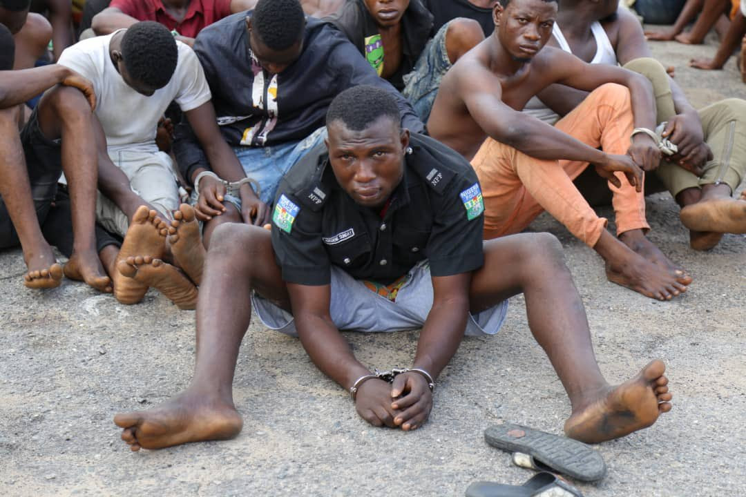 Police parade hoodlum who attacked police station and went away with the DPO's uniform