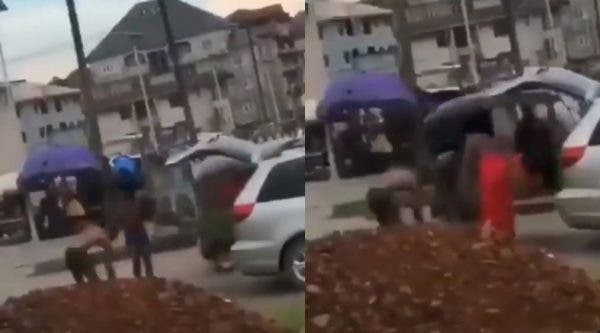 VIDEO: Suspected yahoo boys bath in middle of road as native doctor performs ritual