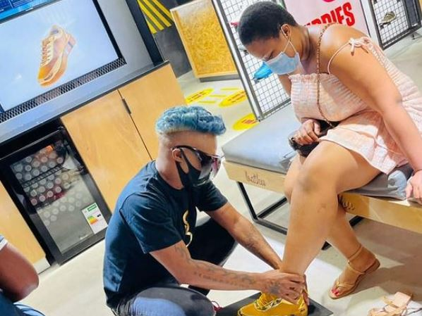 Somizi helps customers try on his new sneakers