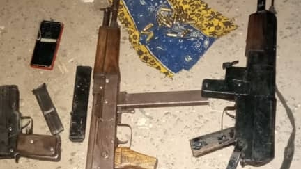 PHOTO: Troops recover arms after killing suspected armed robber in Plateau