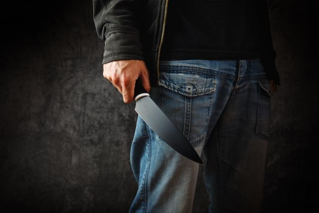 Knife-wielding man storms police station, stabs female officer dead